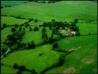 Track over green fields and farm house, England