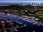 Track over luxury boats and yachts moored in Marina Del Ray, Los Angeles