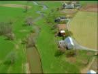 Track over rural fields and farmland including barns and farmhouses, Pennsylvania