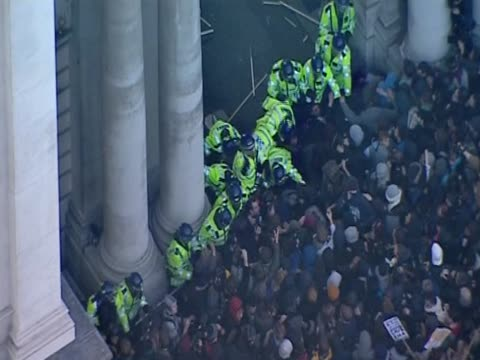 Track over students and police clashing during protest against the proposed rises in university tuition fees