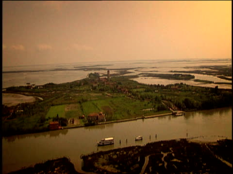 Track over Venetian lagoon to island of Torcello including Torcello Basilica