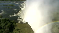 Track over Victoria Falls with an abundance of spray rising, Zimbabwe, Aerial Shot