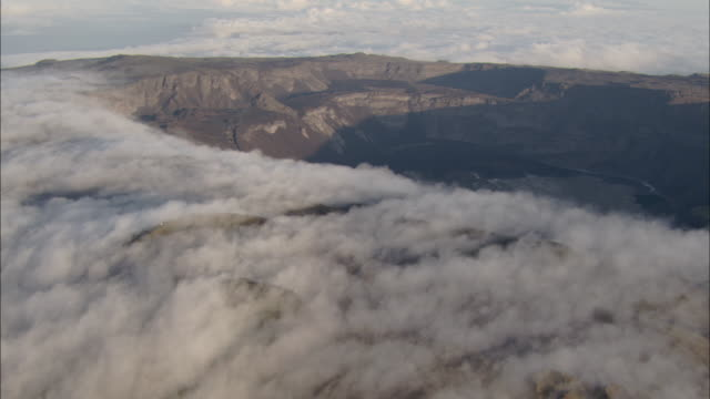 Track past clouds on edge of crater of Sierra Negra Isabela Island Available in HD.