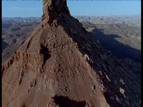 Track past huge rock outcrop in desert, Moab, Utah