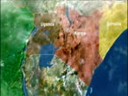 Track right across computer graphics map of equatorial Africa zoom in to Kenya