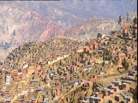 Track right across densely packed houses on mountainside Bolivia