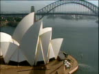 Track right around Sydney Opera House with Sydney Harbour Bridge in background