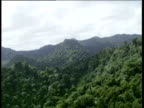 Track right past mountain ridges covered by rainforest Windward Islands