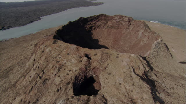 Track round crater of Sombrero Chino island, shadow of helicopter visible Available in HD.