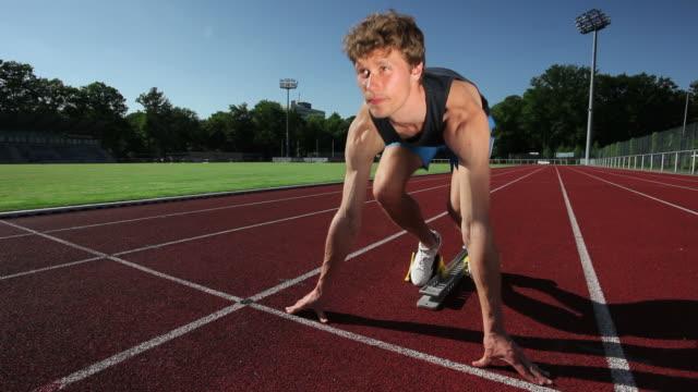Track runner at starting line