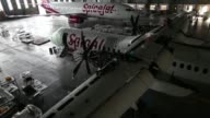 Track up a Boeing Co 7378GJ left and a Bombardier Inc Q400 NextGen passenger aircraft undergo maintenance at the Air Works Engineering Pvt hangar in...
