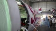Track up a Bombardier Inc Q400 NextGen passenger aircraft undergoes maintenance at the Air Works Engineering Pvt hangar in Belagondapalli Tamil Nadu...