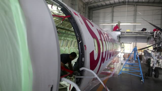 Track up a Bombardier Inc Q400 NextGen passenger aircraft undergoes maintenance at the Air Works Engineering Pvt hangar in Belagondapalli Tamil Nadu...