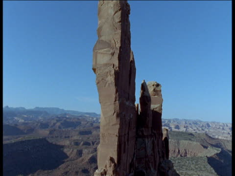 Track up and over huge rock outcrop in desert, Moab, Utah