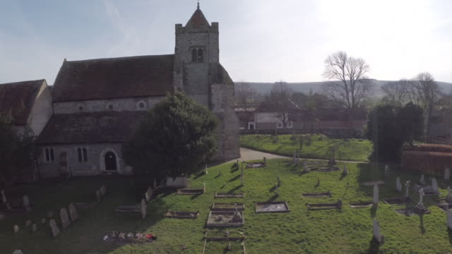 Track up and over Norman church in Firle, Sussex