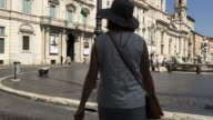 Tracking behind a female tourist admiring the Piazza Navona, Roma