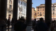 Tracking behind tourists and colonnades of The Pantheon, Rome