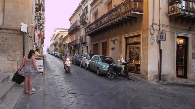 Tracking cars and scooters to reveal the beautiful streets of Noto, Sicily, Italy