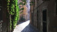 Tracking quaint narrow street of Trastevere, Rome