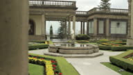 Tracking shot across a formal garden in the Chapultepec Castle, Mexico City.