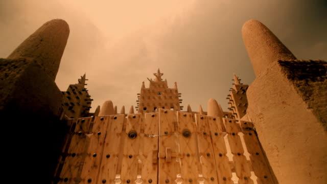 Tracking shot along the gates of the Djinguereber Mosque in Timbuktu.