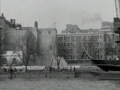Tracking shot along the River Thames facing the north bank