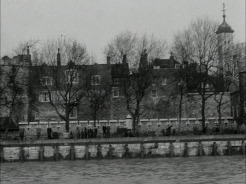Tracking shot along the River Thames passing the Tower of London