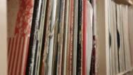 Tracking shot along vinyl rack