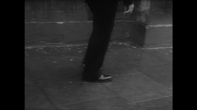 Tracking shot following the feet of a policeman on patrol