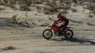 Tracking shot motocross desert