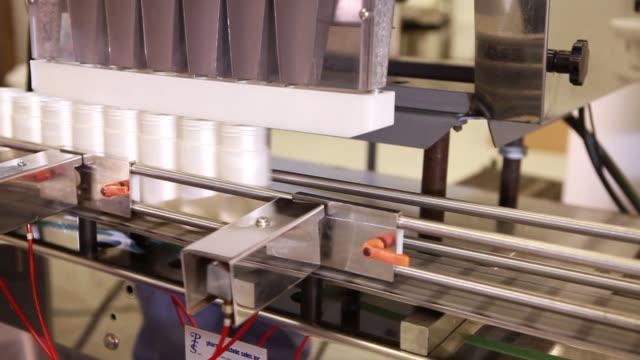 Tracking shot of a bottles on a conveyor belt.