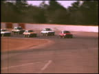 WS tracking shot of a fleet of 1975 AMC Pacers driving on the Riverside International Raceway 1975 AMC Pacers on Riverside International Raceway at...