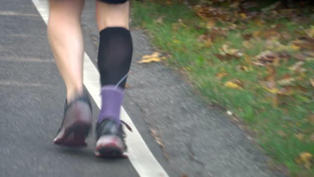 Tracking shot of a male runner feet