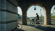 Tracking shot of Bercy bridge, bicycles passing by