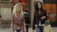 Tracking shot of friends walking in shopping mall / Milan, Italy