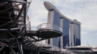 WS TL Tracking shot of Marina Bay Sands hotel and Casino and Helix bridge