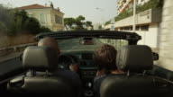 Tracking shot of people taking video in moving car / Nice, France