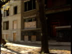 Tracking shot of slum ghetto area mostly empty flats and housing.