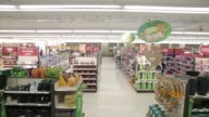 Tracking shot of the aisles inside a Sainsburys supermarket store operated by J Sainsbury Plc in the Wandsworth district of London UK on Wednesday...