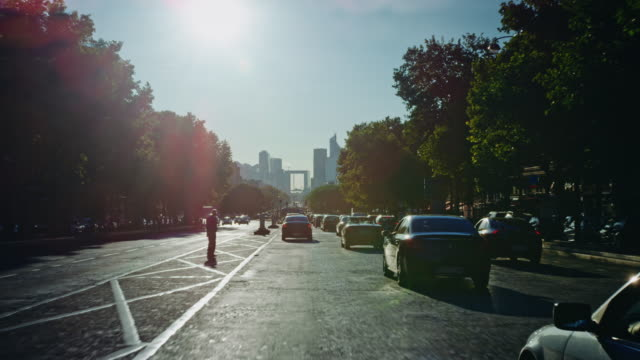 Tracking shot of the Grande-Armée avenue, looking at the Défense district skyline