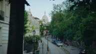 Tracking shot of typical Montmartre streets, Sacré-Coeur Basilica in the background