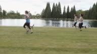 Tracking shot of women's jogging group