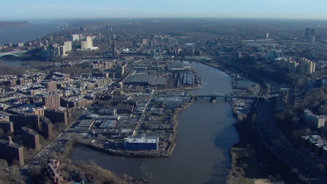 Tracking shot over the Harlem River in New York City, flying west towards the Hudson River.