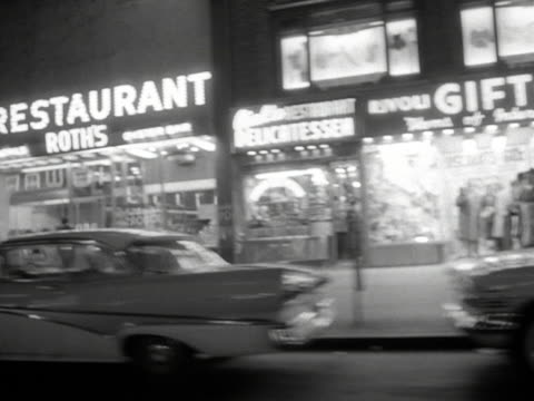 Tracking shot past shops in New York 1959