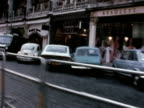 Tracking shot past the Spaghetti House restaurant where seven people are being held hostage by three gunmen 29 Sep 1975