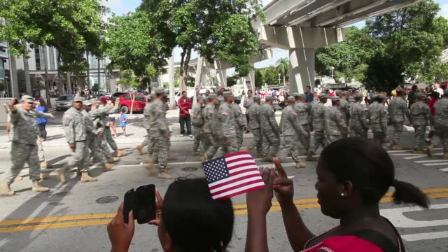 Tracking Shot soldiers marching To honor veterans of the Vietnam War the Bay of Pigs and all wars the city of Miami holds the MiamiDade County Golden...