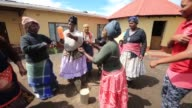 Tracking Shot Xhosa women sing and dance as young men take part in a manhood ceremony in Qunu ahead of the funeral of Nelson Mandela on December 13...