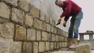Tracking Toward Man Building Wall