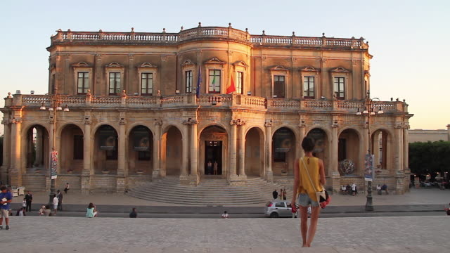 Tracking towards the stunning baroque Ducezio Palace, now the Town Hall, Noto, Sicily, Italy