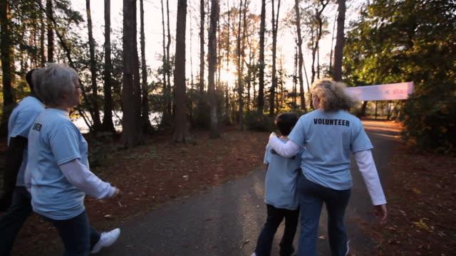 Tracking volunteers walk in charity walk